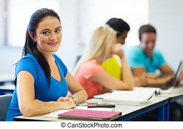 young college girl in lecture hall - beautiful young college...