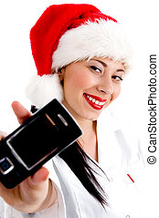 woman wearing christmas hat and showing mobile against white...