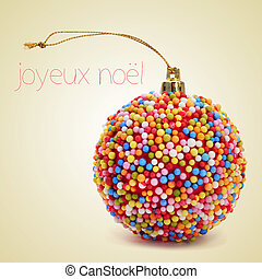 joyeux noel, merry christmas in french - a christmas ball...