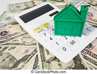 House money and calculator. Mortgage concept background.
