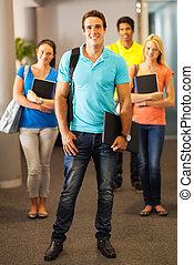 group of college students on campus - group of smiling...