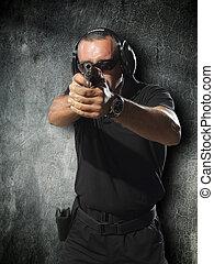 Man shooting gun - Man shooting hand gun