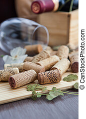 Wine corks on the table with glass and bottle on the...