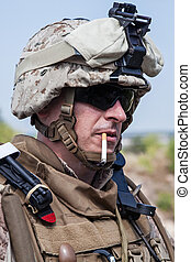 smoking - US marine smoking a cigarette half-turned to the...