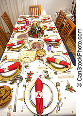 elegant Christmas table decorated with typical and colorful...