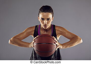 Female basketball player passing the ball - Portrait of...