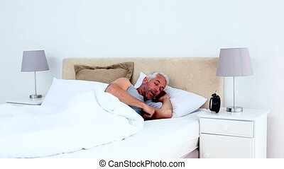 Refreshed man waking up a
