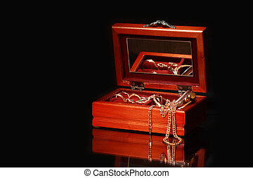 Casket with jewerly - Nice wooden casket with jewelry on...