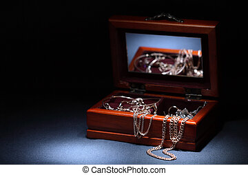 Casket with jewelry - Nice wooden casket with jewelry on...