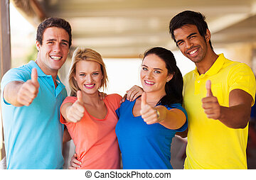 group of friends giving thumbs up - group of cheerful...