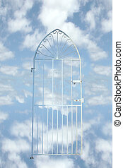 heavens gate - a white wrought iron gate against a cloudy...