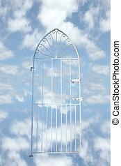 heavens gate - a white wrought iron gate against a cloudy...