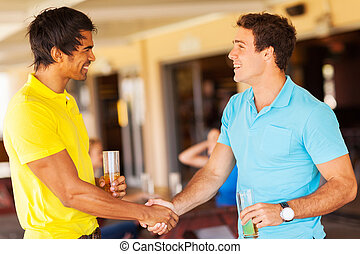 friends handshaking at the party