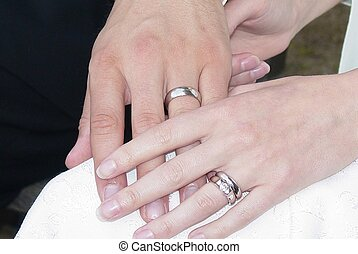 Wedding hands - Young couple holding hands at their wedding....