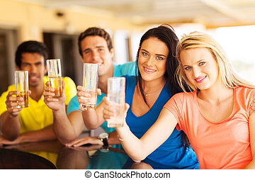 four friends having drinks at bar