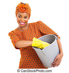 african woman with cleaning tools