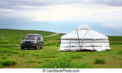 Jeep parked next to yurt - Modern jeep parked next to...