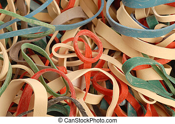 elastic band background - pile of colorful elastic bands -...