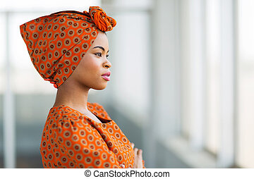 african businesswoman wearing traditional clothes -...