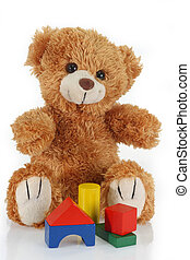 Building bricks - Cute teddy bear on bright background