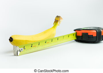 Banana and measuring ta - Close-up of measuring the size of...