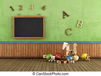 Vintage Play room with toys and blackboard on wall -...