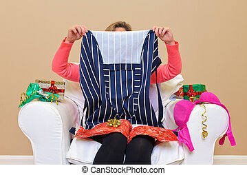 Woman - Look what I got for Christmas - A woman opening...