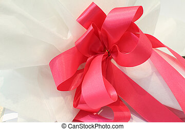 Red ribbon and bow with white bouquet