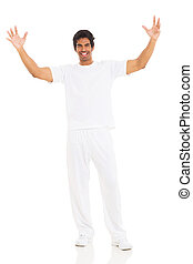young indian man with arms up