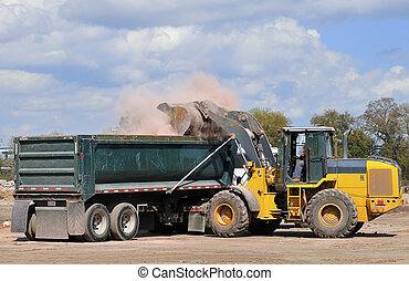 Building demolition site - A large front end loader loading...