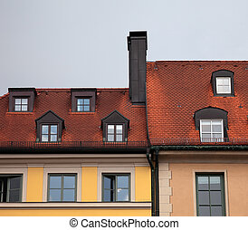 Close-up of houses with red tile roof in Munich, Germany -...