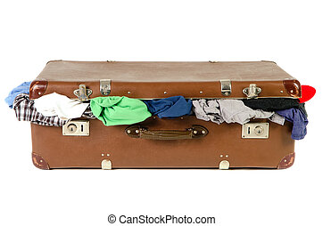 old suitcase full with clothes before white background - old...