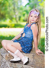 Little girl in jeans dress