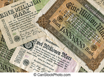 inflation - picture of different old german bank notes...