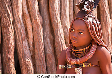 Himba woman - EPUPA, NAMIBIA - AUGUST 4: An unidentified...