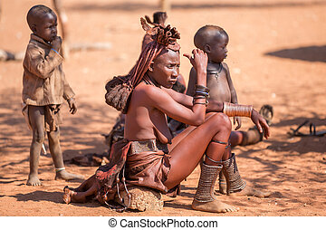 Himba women - EPUPA, NAMIBIA - AUGUST 4: An unidentified...