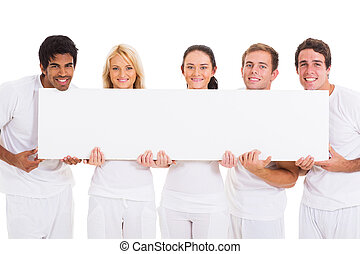 group of friends holding blank banner - group of happy...
