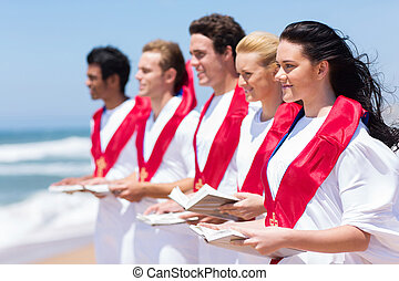 church choir singing on the beach