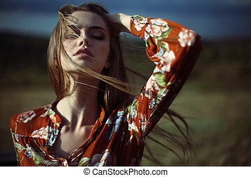 sensual beautiful young woman with developing hair -...