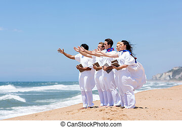young church choir singing on the beach