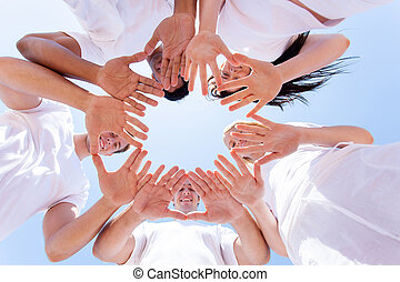 underneath view of people hands together - underneath view...