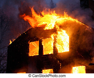 Wooden house in flames - Wooden house buring.
