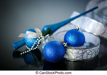 blue balls and ribbon on a black background