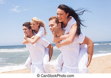 group of friends piggyback and having fun - group of friends...