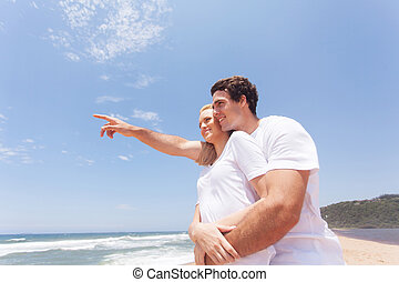 young couple on vacation - beautiful young couple on...