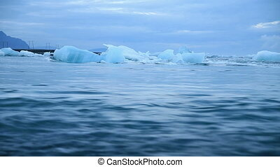 blue icebergs - Blue icebergs floating in Jokulsarlon...