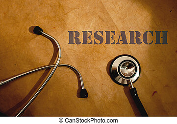 Medical research - Research typescript next to a stethoscope