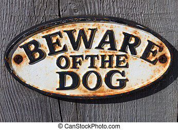Beware of the dog sign - A beware of the dog sign on a...