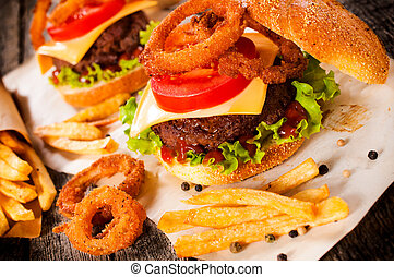 American cuisine with cheesburger, onion rings and french...