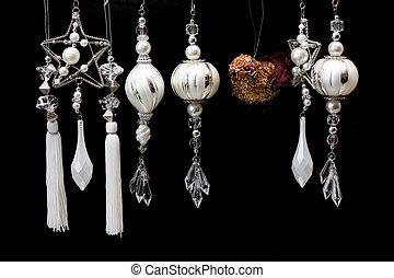 Silver and White Christmas Tree Ornaments on Black - a row...